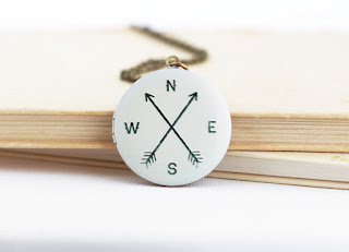 http://www.jacarandadesigns.com/collections/lockets/products/travel-gift-compass-locket-bon-voyage-gift-for-traveler-wanderlust-locket-necklace-compass-jewelry