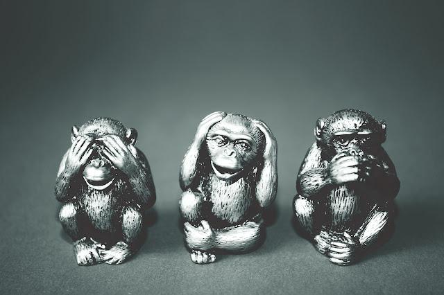 Three monkey figurines, see no evil hear no evil speak no evil