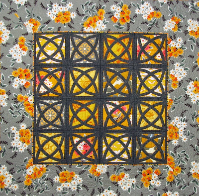 Grey Gardens wallhanging quilt made with La Fiesta blocks