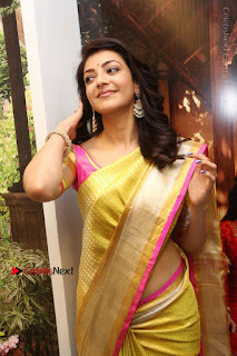 Actress Kajal Agarwal Stills in Golden Silk Saree at Trisha Sesigner Store Launch  0038.jpg