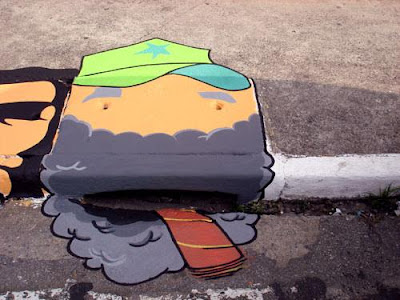 Arte callejero en alcantarillas.