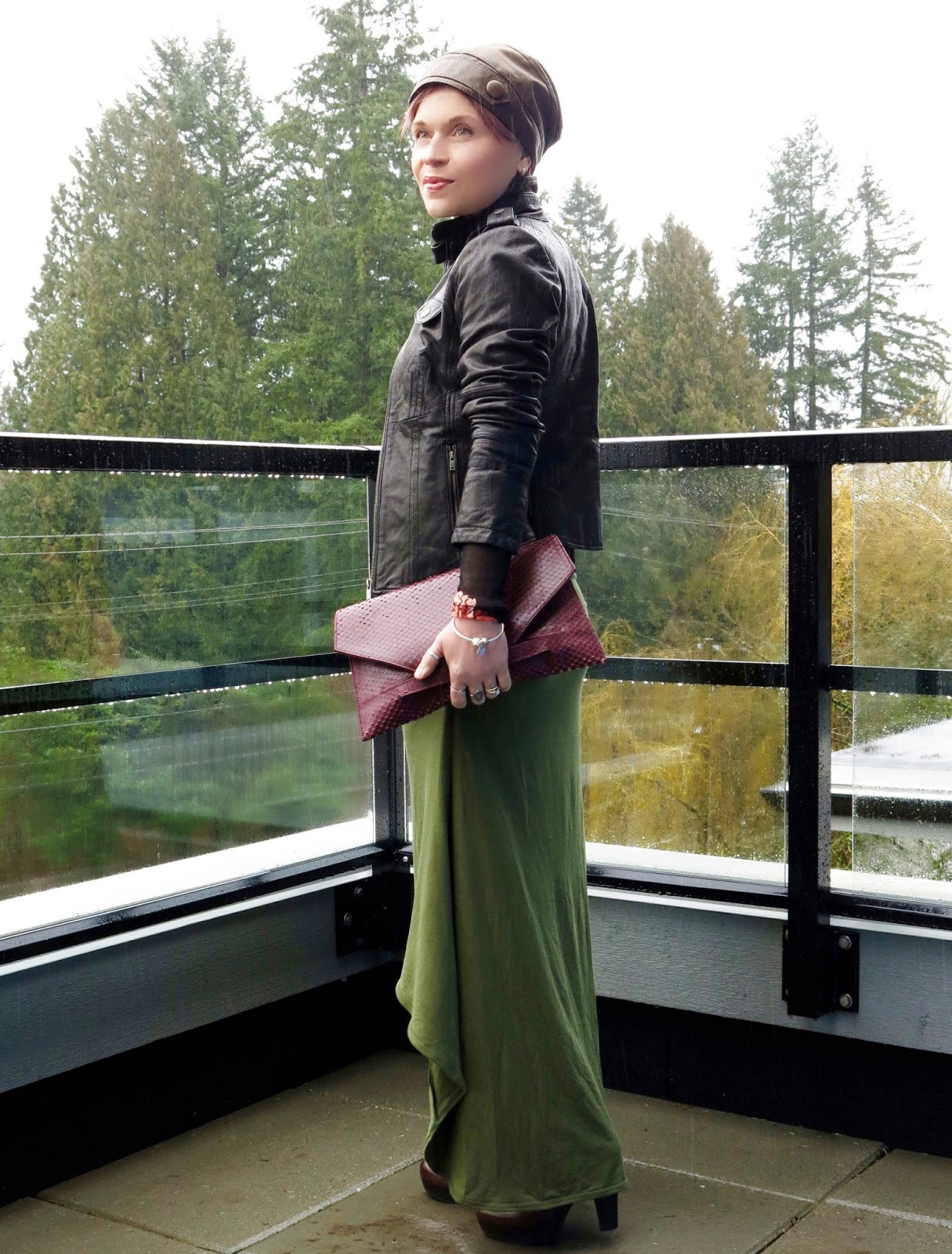 styling a high-low dress with a sheer floral top, moto jacket, leather beanie, and platform booties