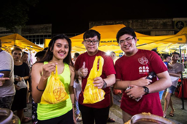 Happy Faces Of A Satisfied Customer At The Night Market