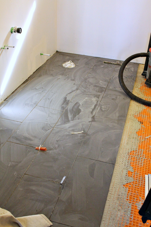 Floor getting tiled