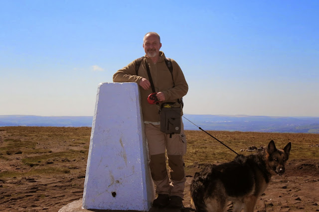 A picture of me and our German Shepherd, Lotte, by the trig column on Pendle Hill.