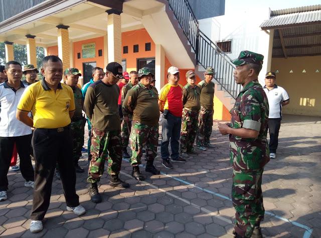 Koramil 0815/03 Sooko Bersama Tiga Pilar Kecamatan dan warga masyarakat melaksanakan Karya Bakti