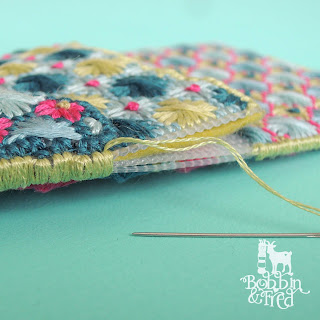 Create a layered but flat piece of plastic canvas with overcast stitch