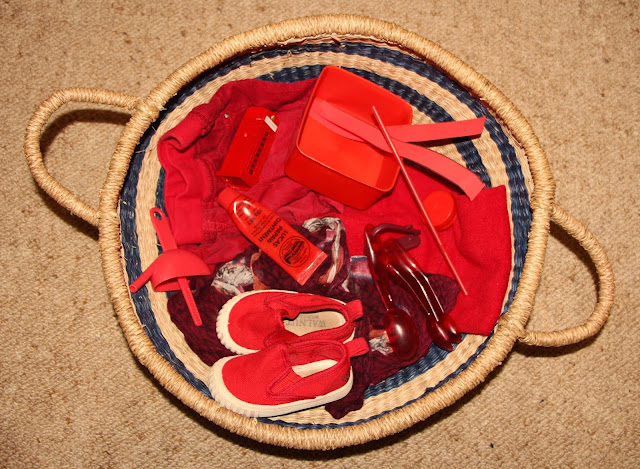 Treasure baskets with red objects