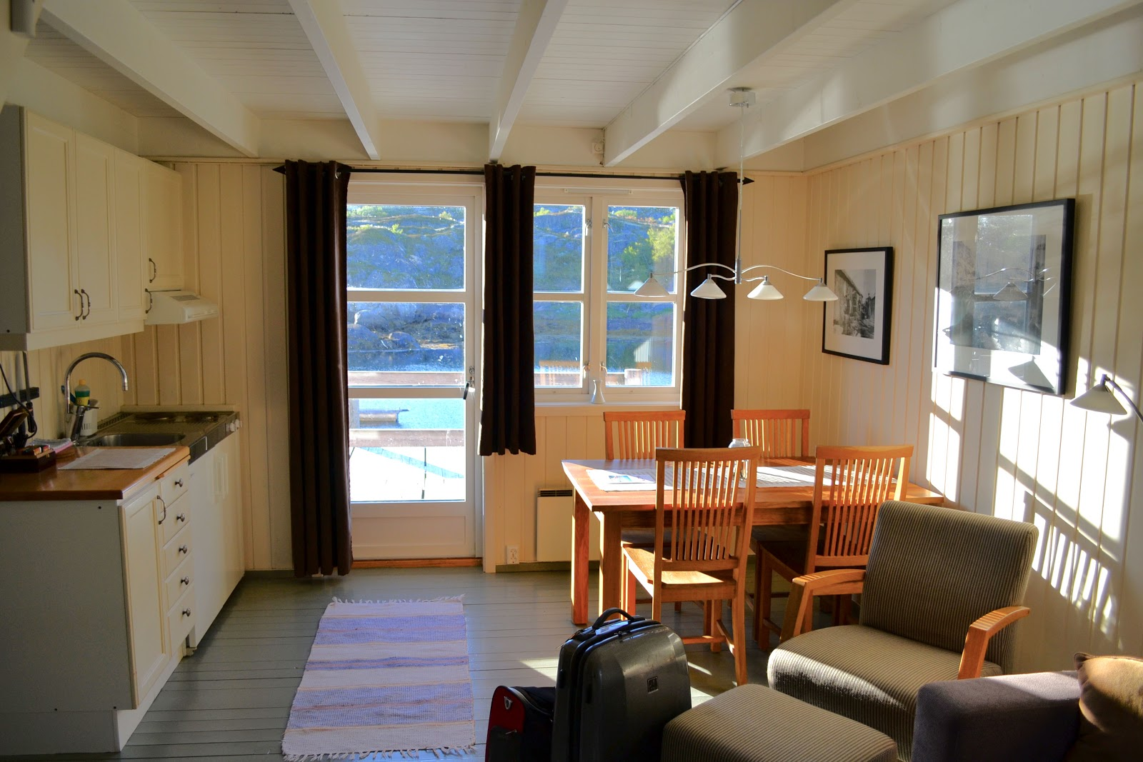 Kitchen and dining room overlook the fjord.