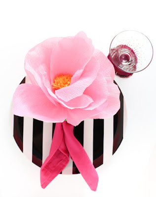 http://overthebigmoon.com/crepe-paper-flower-napkin-rings/