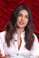 Priyanka Chopra in White Shirt and Colorful Skirt at Baywatch Press Conference  15th May 2017 ~  Exclusive 26.jpg