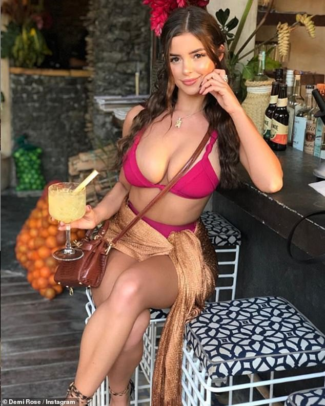 Demi Rose flaunts her jaw-dropping curves in a skimpy hot pink bikini
