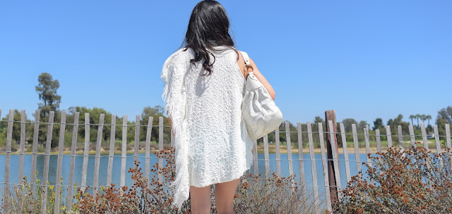 Luis Vuitton Medium White Mahina Hobo with perforated eyelet design and gold hardware Free People Cream Fringe Tunic
