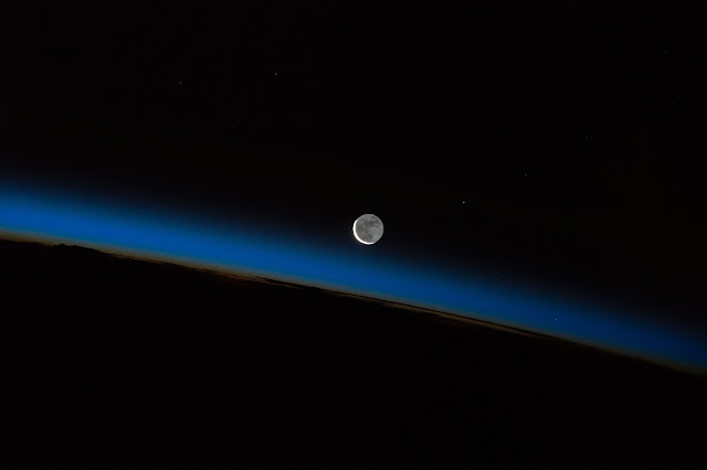 Moon and Earth's Atmosphere seen from International Space Station