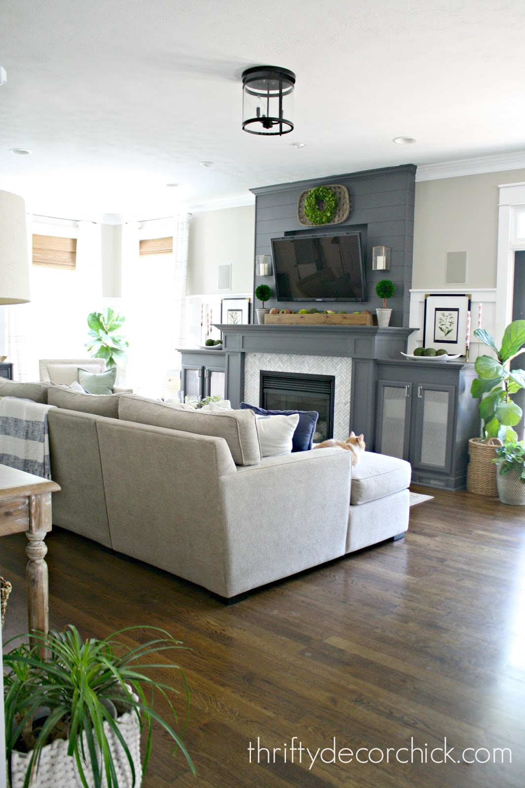 dark gray fireplace with DIY built ins