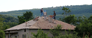Workers on the roof of a neighbouring house