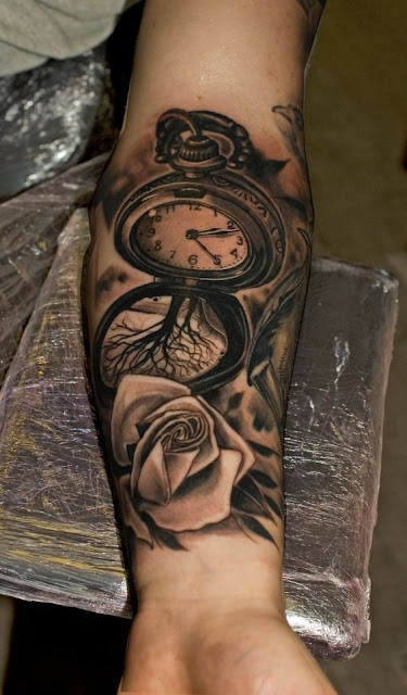 Attractive Clock Tattoo Designs on Arm