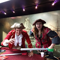 male and female adults dressed as classic 17th century pirates