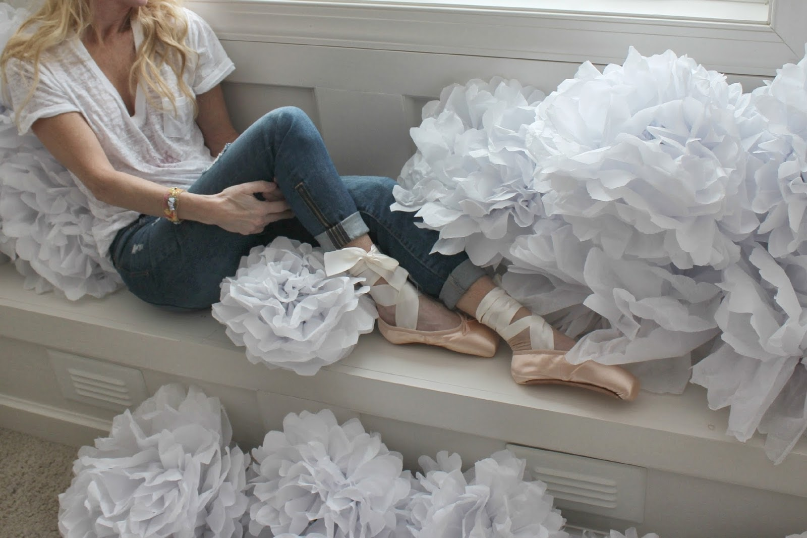 Michele of Hello Lovely in pointe shoes with tissue paper poufs