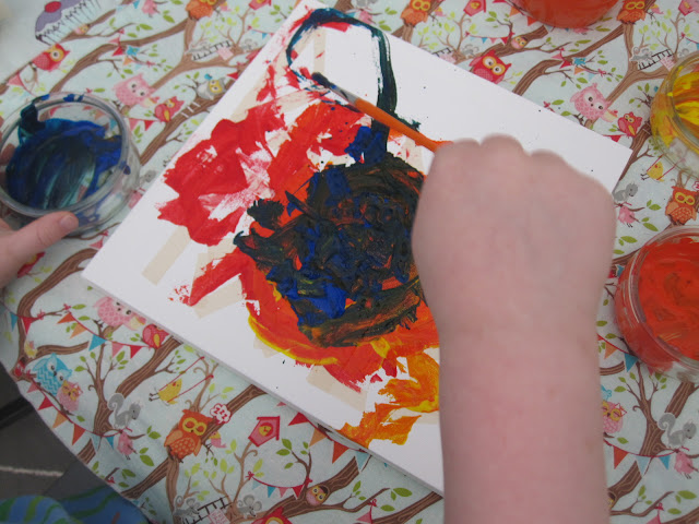 Canvas being painted by a child