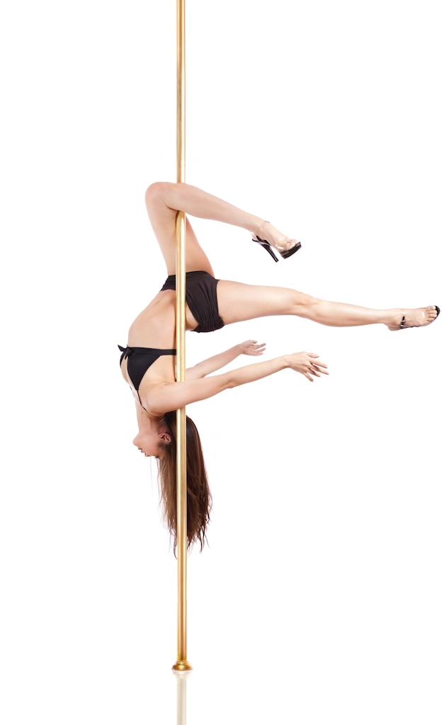 FLEXIBLE AND STRONG: Ms Sue-Anne Lim, a student at Bobbi's Pole Studio in Queen Street in Singapore, demonstrates a pole-dancing move. Body, soul, and pole - Gemini hang