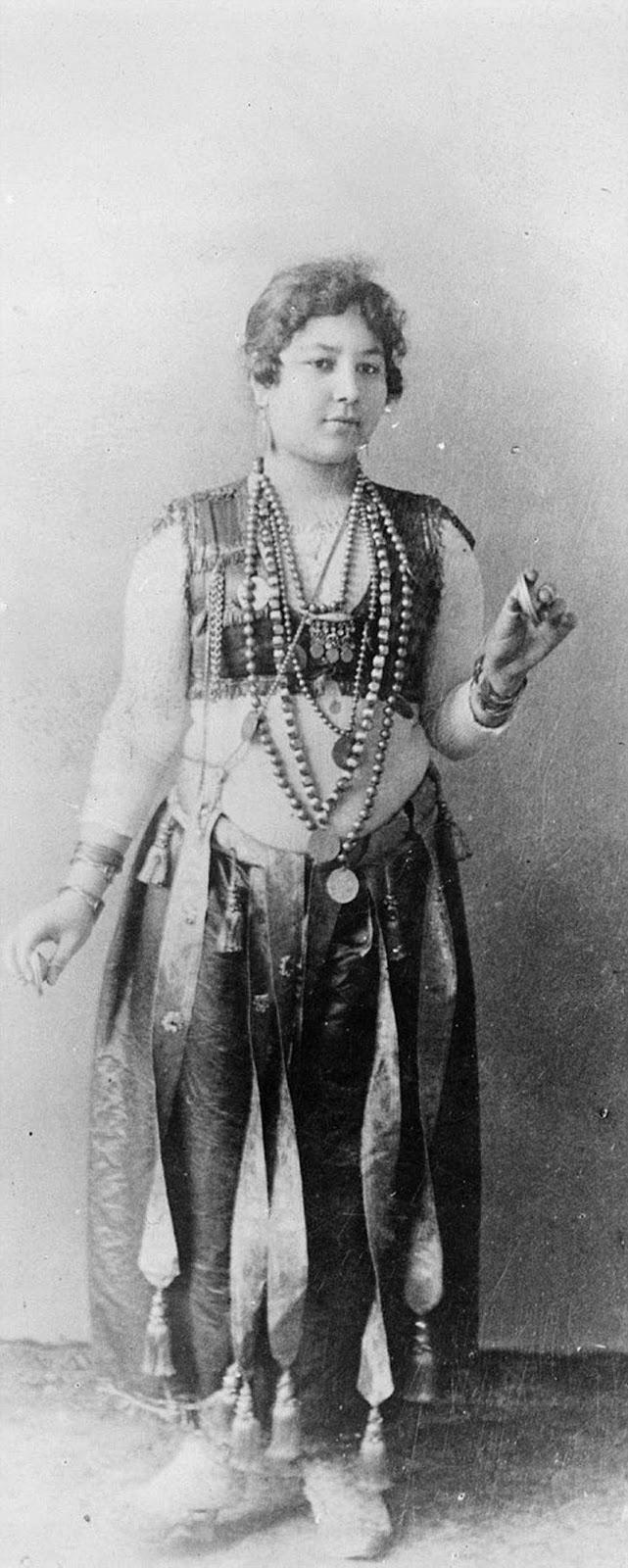 An Egyptian dancing girl at the World's Columbian Exposition, Chicago, Illinois, USA, circa 1893.