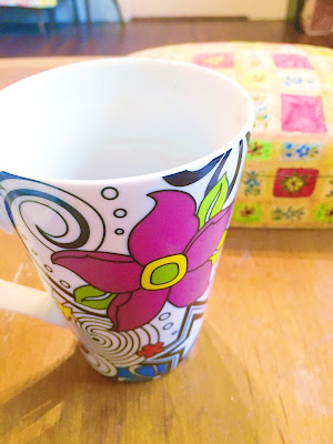 a funky 60s floral pattern mug for tea or coffee