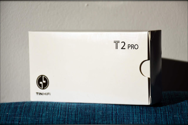 Tin T2Pro Package, resting on a blue surface, white background