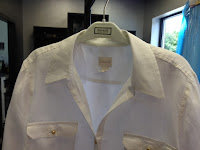 A linen shirt with stained collar and scuffs