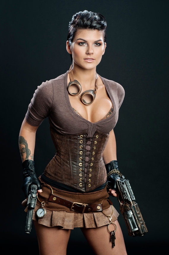 Modern steampunk woman with short hair wearing modern steampunk clothing in shades of brown. corset, goggles, guns, gloves, skirt, bra with gears
