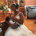Woman breastfeeds her child during her wedding ceremony ..photo