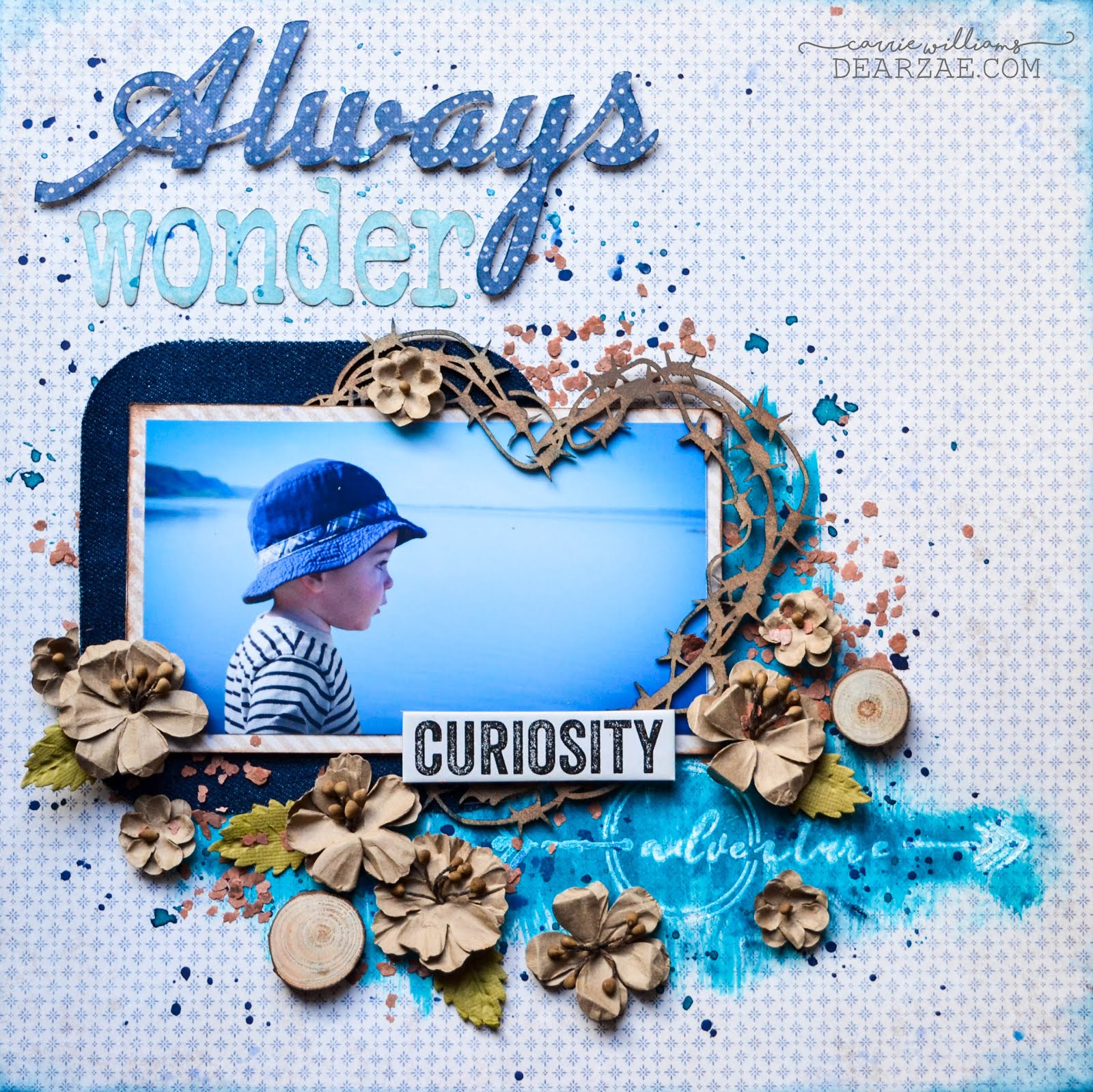 Mixed media scrapbook layout in blue and kraft linen brown neutral with barbed wire heart chipboard frame. Featuring Maja Denim and Friends papers, 49&Market flowers, Tim Holtz phrase chips and wood slices with mica flakes and Lindy's sprays and Kaisercraft Kaisermist