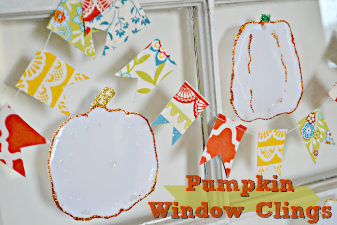 Pumpkin window clings with orange and green and gold glitter around the edges
