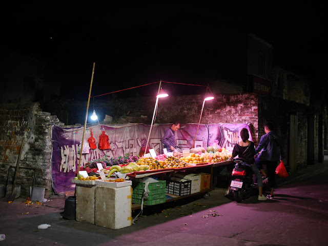 fruit stand at night in Zhongshan, China