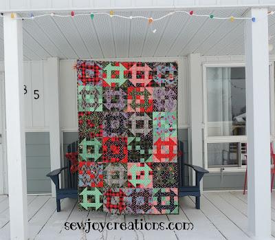 tula pink fabric christmas quilt made of churndashes