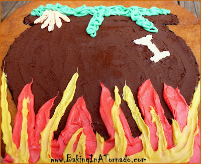 Witch's Caldron Giant Cookie: A giant cookie decorated with chocolate and white frosting for delicious Halloween fun | Recipe developed by www.BakingInATornado.com | #recipe #Halloween