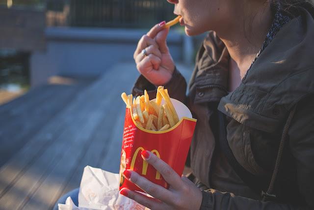 Image: Girl Eating McDonalds Fries, by Joanna Malinowska on FreeStocks