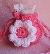http://www.ravelry.com/patterns/library/small-flower-gift-bag
