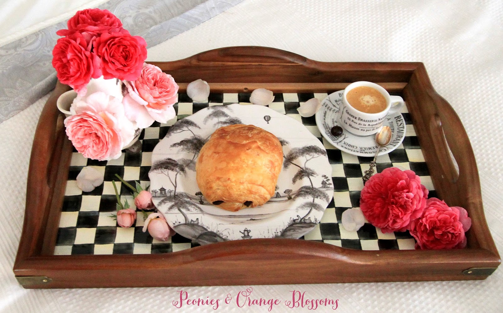 A French breakfast in bed with a pain au chocolat and espresso! Fit for a Queen!