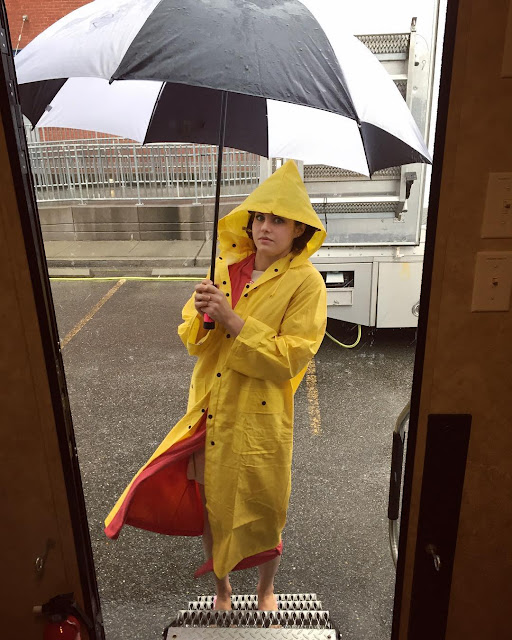 alexandra-daddario-in-yellow-rain-cot