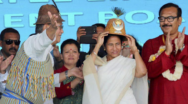 West Bengal Chief Minister Mamata Banejee wears a traditional headgear at the 5th founation day function of Lepcha Development and Cultural Board at Kalimpoog in Darjeeling