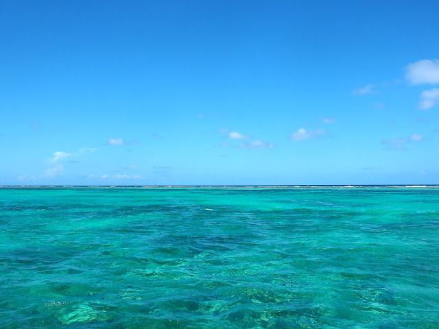Blue skies and turquoise ocean lagoon around Caye Caulker, Belize