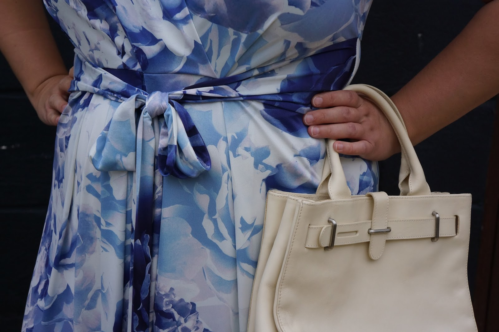phase 8 blue and white flower dress detail with a bow and furla hand bag