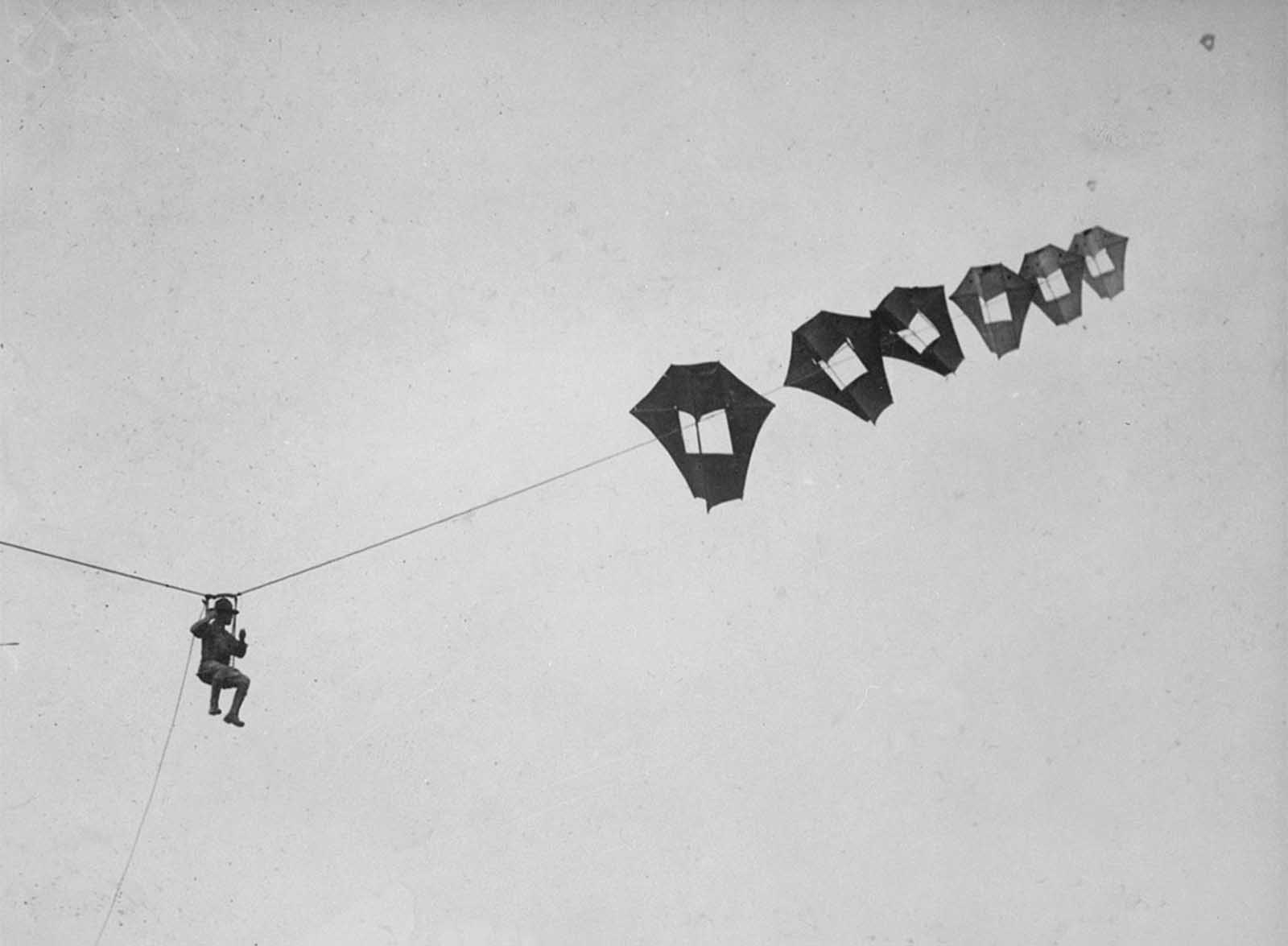 Lieutenant Kirk Booth of the U.S. Signal Corps being lifted skyward by the giant Perkins man-carrying kite at Camp Devens, Ayer, Massachusetts. While the United States never used these kites during the war, the German and French armies put some to use on the front lines.