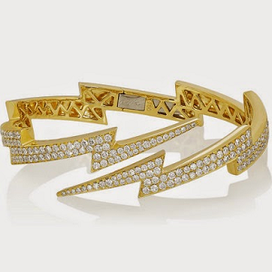 Anita Ko Diamond Cuff Lightning Bolt Cut The lightning bolt bracelet from Anita Ko is a quite a stunning piece. It's made of 18 karat gold and has the two lightning bolts covered in diamond pave. Certainly a show stopping piece.