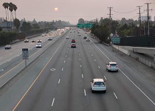 Smoky sunset viewed from pedestrian/bike bridge over State Highway 101, Sunnyvale, Calfironia