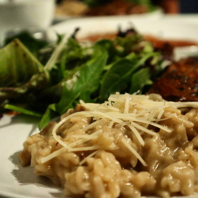 A plate of creamy mushroom risotto cooked using the Instant Pot's pressure cooker mode.
