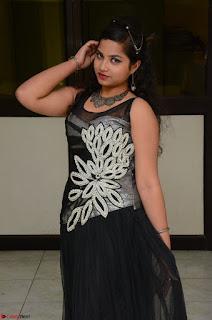 Shrisha Dasari in Sleeveless Short Black Dress At Follow Follow U Audio Launch 056.JPG
