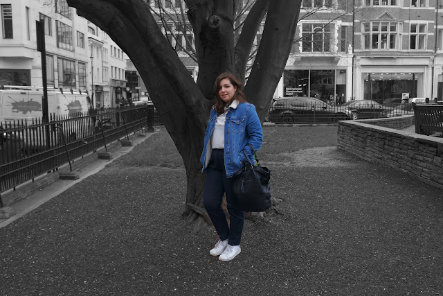 Denim Jacket, white top and navy trousers styled with a neckerchief.