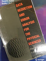 Data Reduction and Error Analysis  for the Physical Sciences,  by Philip Bevington and Keith Robinson, superimposed on Intermediate Physics for Medicine and Biology.